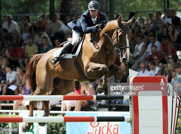 Regis Villain of France clears a hurdle with his horse Monark during the international horse jumping 'Nations Cup' tournament in Bratislava, on August 7, 2009. France won the tournament ahead of Poland and Switzerland. AFP PHOTO / SAMUEL KUBANI (Photo credit should read SAMUEL KUBANI/AFP/Getty Images)